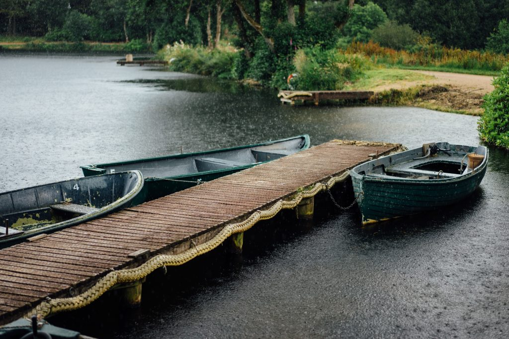 Rain is part of the adventure travel industry, don't let it stop your business like it did to these three boats next to a dock. Photo by Paul Rysz